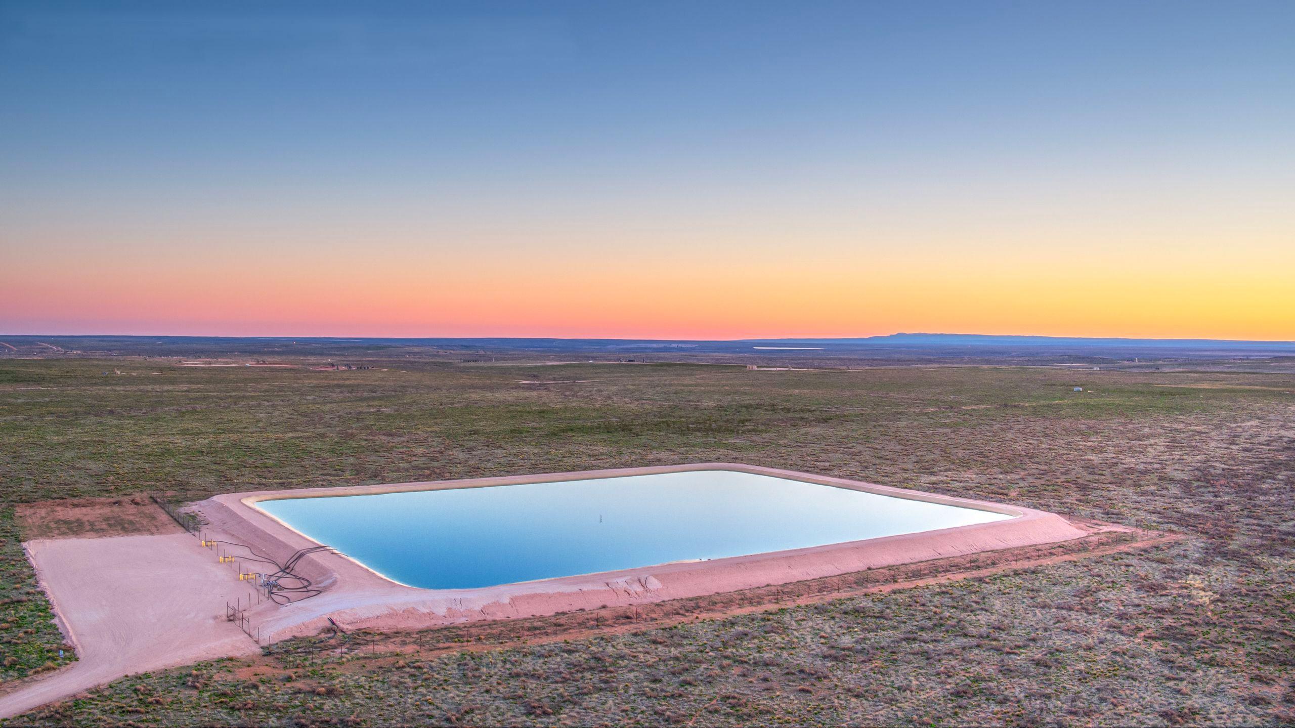 Frac pond with sunset